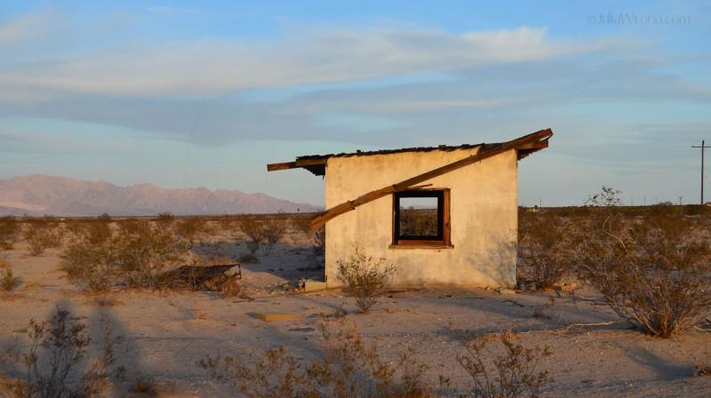 Desert shack at sunset