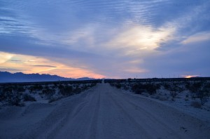 Sunset over a sand road in the desert