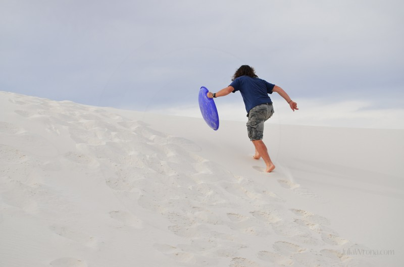 Running up a sand dune in White Sands National Park