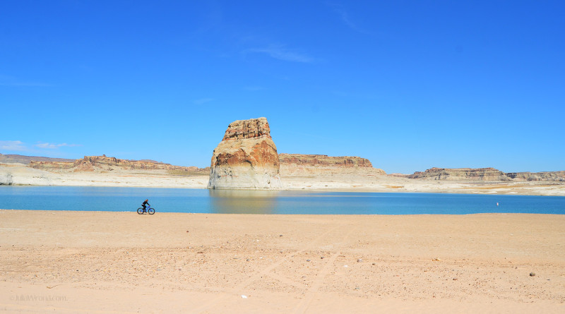 Bicyclist on beach in Lake Powell