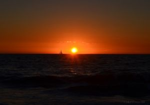 A Sailboat at Sunset